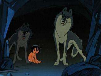 Raksha and Father Wolf protecting Mowgli