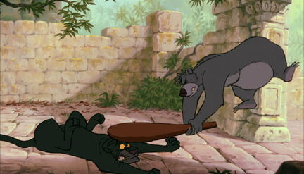 Baloo the Bear has hit Bagheera the Black Panther with a club