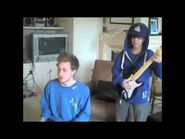 Justin plays Rockband with Asher Roth