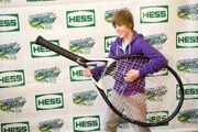 Justin Bieber holding an oversized tennis raquet