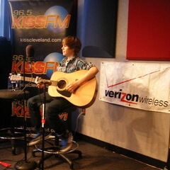 Justin and his guitar - playing for a room full of winners.