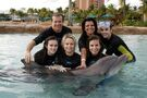 Justin Bieber and Caitlin with a dolphin