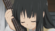 Mio with her bass