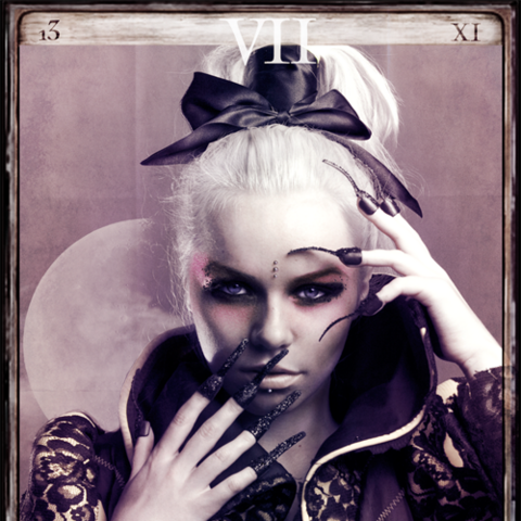 Greta Laus designed the tarot card layout featured in this image.