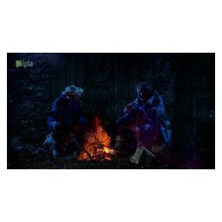 Marian i Ferdek przy nocnym ognisku.