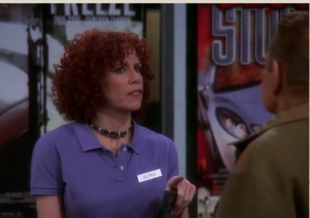 File:Gloria confronts Arthur at Video Store.png