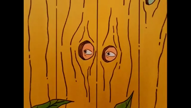 File:Dale Gribble hiding behind fence.png