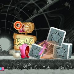 Kirby usando su super-inhalación con bloques de piedra.