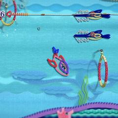 Kirby transformado en delfín en el agua.