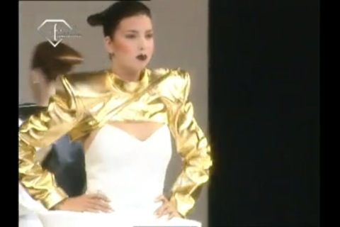 File:Jeremy Scott Spring 1999 Gold metallic leather shrug.jpg