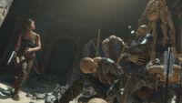 Lara Near Pile of Bodies