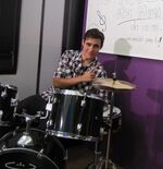 Jorge playing the drums