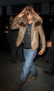 Ne-Yo-wearing-hooded-fur-jacket-and-Louis-Vuitton-Tibet-nubuck-calf-leather-ankle-boots-1