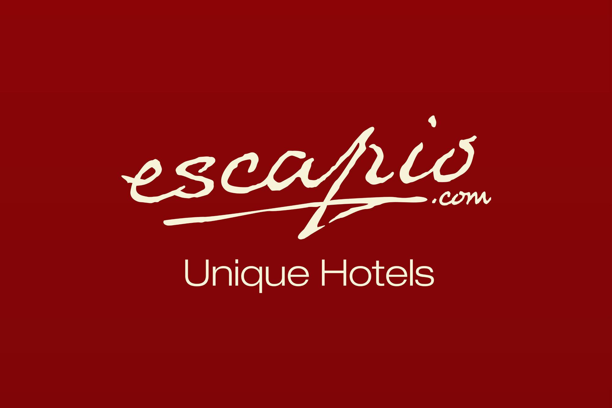 Escapio hotels logopedia fandom powered by wikia for Escapio hotels