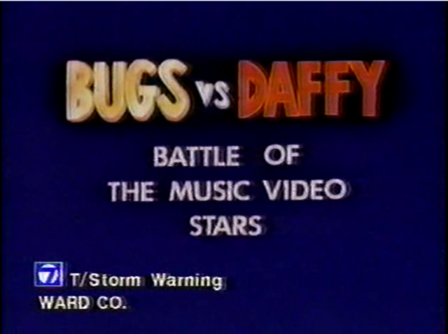 File:Bugs vs. Daffy - Battle of the Music Video Stars.png