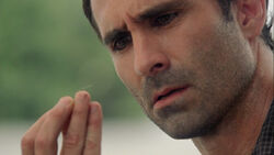 Richard looks at his first gray hair