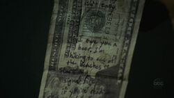 La metà inferiore della banconota da $20 del vero Henry Gale.