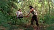 3x19 Sayid with shovel.jpg