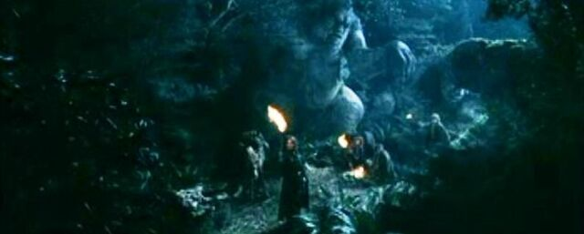 File:Aragorn and company near a troll that turned into a stone 02.jpg