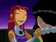 Teen Titans Starfire has gived Robin a neckless