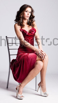 File:Stock-photo-young-brunette-woman-in-elegant-red-dress-sit-on-chair-full-body-shot-studio-shot-69142603.jpg