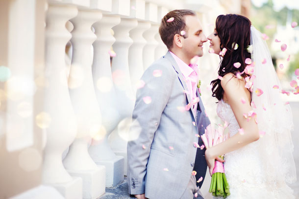 File:Adriana and Jason outside the church in petals.JPG