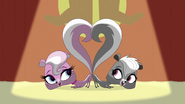 Mitzi and Pepper's tails up