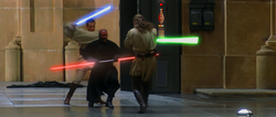 Three men fight with laser swords in an hangar.
