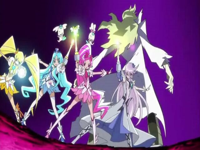 File:Heartcatch Pretty Cure! Cure Blossom, Marine, Sunshine and Moonlight finishing the Floral Power Fortissimo attack.jpg