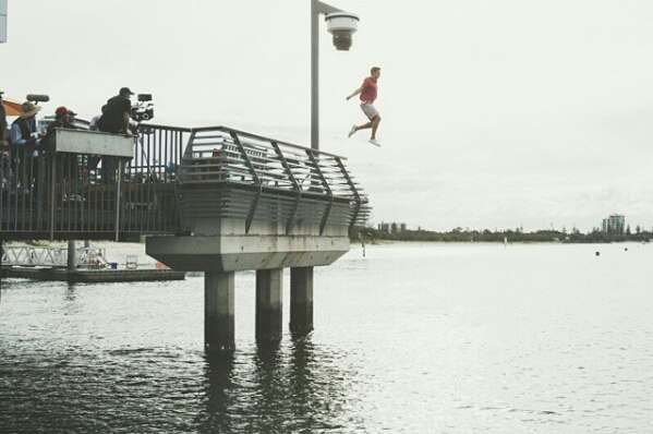File:Erik jumping off pier.jpg