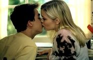 Nikki and Malcolm kissing