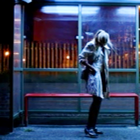 Alice in the bus stop.