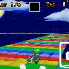 Luigi on <small>SNES</small> Rainbow Road.