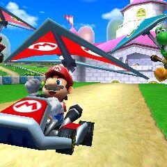 Mario, Peach, and Yoshi gliding on Mario Circuit.
