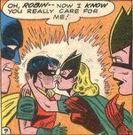 Bat-Girl kisses Robin