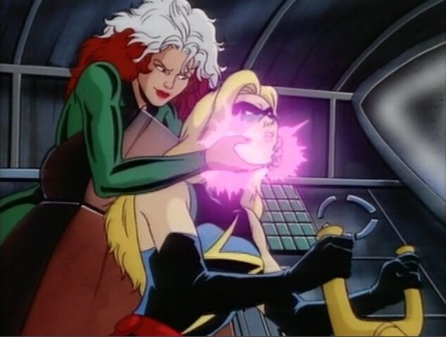 File:Rogue Grabs Ms Marvel.jpg