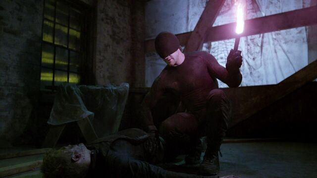 File:Murdock lits the flare to burn Ranskahov's open wound & sealing it.jpg