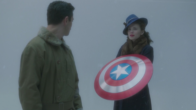 File:Peggy with Cap's shield.png
