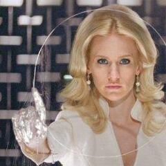 Emma Frost using her diamond skin to cut glass.
