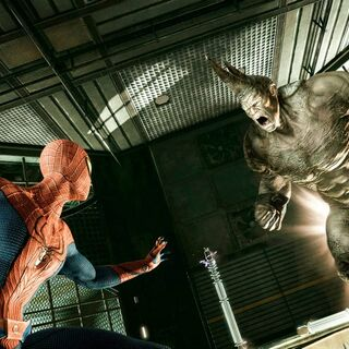 The Rhino charges at Spider-Man.