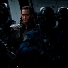 Loki being taken as a prisoner.