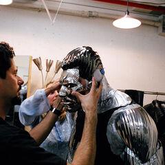 Behind the Scenes image of Daniel Cudmore having metal prosthetics applied.