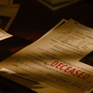 Bucky's file beneath Peggy's as Steve reads Howard Stark's.