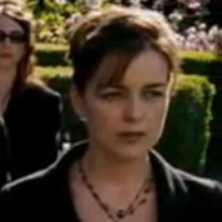 Moira attends Charles' funeral.