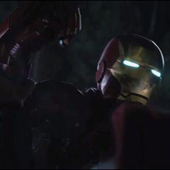 Thor crushing Iron Man's armor.