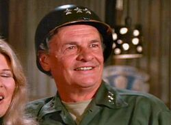 James Gregory as Iron Guts Kelly