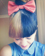 Melanie-martinez-blonde-black-hair-bun-1