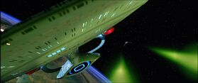 Intrepid evades a Klingon Bird-of-Prey
