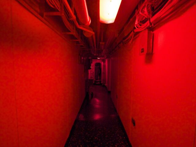 File:And-navigating-my-way-to-bed-in-the-dim-red-light-that-bathes-the-inside-of-the-wasp-at-night--the-red-keeps-the-vessel-from-being-seen-by-the-enemy-and-maintains-sailors-night-vision.jpg