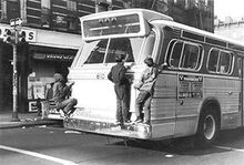LATE 1960s CR & L BUS, BPT. CT - KIDS RIDING BACK BUMPER (street location unknown)